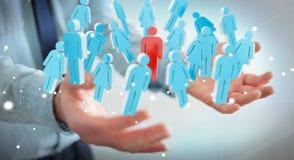 Homme d'affaires tenant 3D rendant le groupe de personnes dans sa main Photographie stock