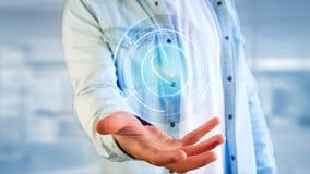 Homme d'affaires tenant un bouton technologic de téléphone de Shinny - rende 3d Photos libres de droits