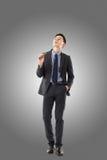 Homme d'affaires tenant un cigare images libres de droits
