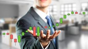 Homme d'affaires tenant un diagramme virtuel de cours des actions d'actions Photo libre de droits