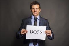 Homme d'affaires tenant un panneau de patron Photos stock
