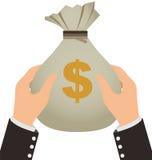 Homme d'affaires tenant un sac d'argent Image stock