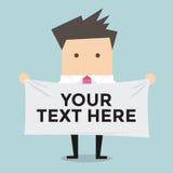Homme d'affaires tenant une bannière pour votre texte Photos stock