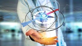 Homme d'affaires tenant une boussole de navigation - 3d rendu Image libre de droits