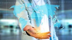 Homme d'affaires tenant une carte reliée du monde sur un interf futuriste Images stock