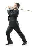 Homme d'affaires tirant une corde Image stock