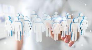 Homme d'affaires touchant 3D rendant le groupe de personnes avec son finge Photographie stock