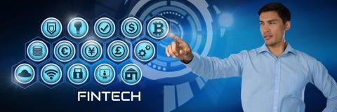 Homme d'affaires touchant Fintech avec de diverses icônes d'affaires Photographie stock