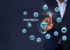 Homme d'affaires touchant Fintech avec de diverses icônes d'affaires Image libre de droits