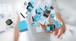 Homme d'affaires touchant le renderi brillant bleu de flottement du réseau 3D de cube Photographie stock libre de droits