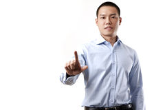 Homme d'affaires touchant un écran imaginaire Image stock