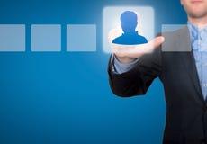 Homme d'affaires Touching Profile Button et case à cocher de coutil Photo stock