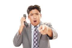 Homme d'affaires très fâché Photographie stock libre de droits
