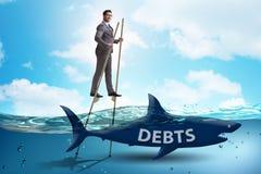 Homme d'affaires traitant avec succ?s des pr?ts et des dettes photo stock
