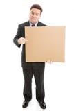 Homme d'affaires triste avec le signe de carton image stock