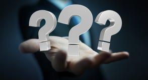 Homme d'affaires utilisant des points d'interrogation du rendu 3D Photographie stock libre de droits