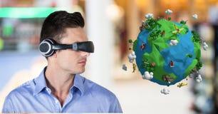 Homme d'affaires utilisant l'écouteur de VR par la basse poly terre Photographie stock
