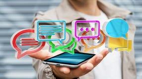 Homme d'affaires utilisant l'ico coloré numérique de conversation du rendu 3D Photographie stock libre de droits