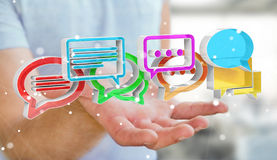 Homme d'affaires utilisant l'ico coloré numérique de conversation du rendu 3D Photographie stock