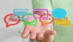 Homme d'affaires utilisant l'ico coloré numérique de conversation du rendu 3D Images libres de droits