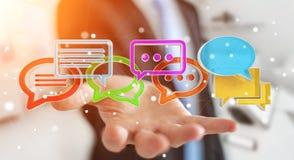 Homme d'affaires utilisant l'ico coloré numérique de conversation du rendu 3D Image libre de droits