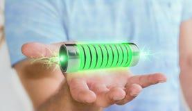 Homme d'affaires utilisant la batterie verte avec le rendu des foudres 3D Photos stock