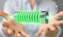 Homme d'affaires utilisant la batterie verte avec le rendu des foudres 3D Photographie stock libre de droits
