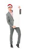 Homme d'affaires utilisant le chapeau de Santa Claus photographie stock libre de droits