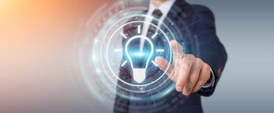 Homme d'affaires utilisant le rendu de l'interface 3D d'idée d'ampoule Image stock
