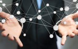 Homme d'affaires utilisant le rendu de la connexion 3D de boules de réseau de vol Photos stock