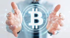 Homme d'affaires utilisant le rendu du cryptocurrency 3D de bitcoins Photos libres de droits