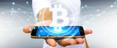 Homme d'affaires utilisant le rendu du cryptocurrency 3D de bitcoins Photographie stock