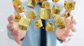 Homme d'affaires utilisant le rendu du cryptocurrency 3D de bitcoins Photos stock