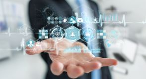 Homme d'affaires utilisant le rendu médical numérique de l'interface 3D Images stock