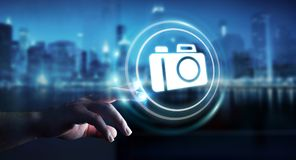Homme d'affaires utilisant le rendu moderne de l'application 3D d'appareil-photo Image stock