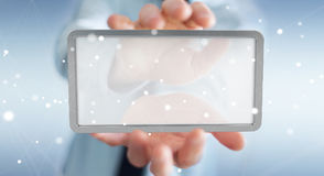 Homme d'affaires utilisant le rendu numérique du comprimé 3D d'écrans Photo stock
