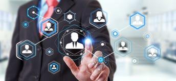Homme d'affaires utilisant le rendu social numérique du réseau 3D Photo stock