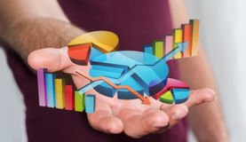 Homme d'affaires utilisant les diagrammes 3D numériques et les barres Photo stock
