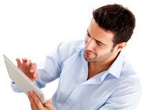 Homme d'affaires utilisant un ordinateur de tablette Photo stock