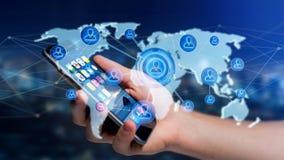 Homme d'affaires utilisant un smartphone avec un réseau au-dessus de W relié Images stock