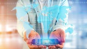 Homme d'affaires utilisant un smartphone avec une carte reliée du monde - 3d r Photographie stock