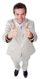 Homme d'affaires victorieux avec des pouces vers le haut Photo libre de droits