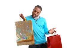 Homme d'Afro-américain avec des sacs à provisions Photographie stock libre de droits