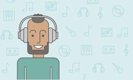 Homme dans des écouteurs Photos stock