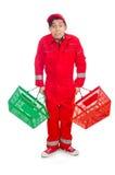 Homme dans des combinaisons rouges Photographie stock