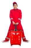 Homme dans des combinaisons rouges avec le chariot de supermarché d'achats Images libres de droits