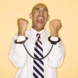 Homme dans des menottes. photographie stock libre de droits