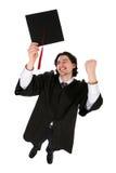 Homme dans des robes longues de graduation Photo stock