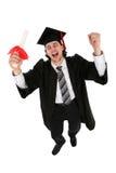 Homme dans des robes longues de graduation Images libres de droits
