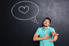 Homme dans l'amour te donnant sa main au-dessus de fond de tableau Photos libres de droits